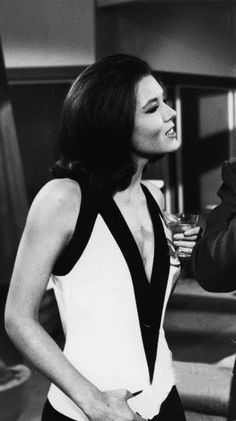 "Diana Rigg may have looked sportive in ""The Danger Makers"" wearing this sleeveless, low-cut white-and-black top from John Bates for his Jean Varon line..."