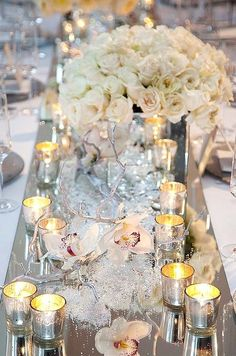 mirror table runner, reflects flowers and light beautifully for Christmas