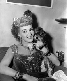 Betty Grable and her miniature French poodle