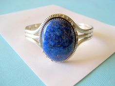 Navajo WT Johnson Sterling Silver and Lapis Cuff Signed by sparklinglotusdesign on Etsy https://www.etsy.com/listing/235398307/navajo-wt-johnson-sterling-silver-and