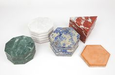 These trivets are excessively luxurious objects. Cut from various stones. My favorites are the blue and red.