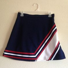 | New | 90s/00s Varsity Cheerleader Skirt • Fits 26/27 waist best • Knit material with white and sparkly red stripes-- the rest is navy blue • Zips up the back and buttons to adjust to waist size • Excellent condition, no flaws-- Go team!!  Vintage Skirts