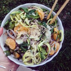 Soba noodles!  I added stir-fried spinach, zoodles, ginger, cloves, chili powder, peanuts and tangerines, topped with tahini and sesame seeds