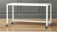 CB2: Go-cart white rolling console table; possible over file cabinets in bold color