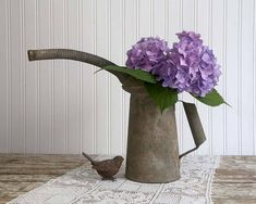 This vintage oil can says rustic farmhouse decor all over it. It is a two quart, galvanized oil can most likely used in the automotive industry. It is 10½ high Base is 5 diameter from spout to handle, it is about 17 It is fairly heavy. When the tulips come up in the spring, to