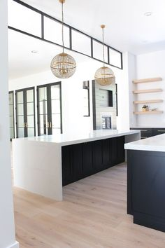 Black steel transom modern kitchen with black cabinets double islands