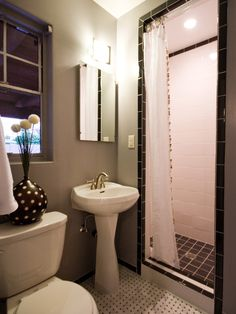install standard black and white subway tiles in the shower and splurge on mosaic glass tile for the bathroom floor