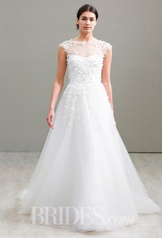 A soft @jimhjelm wedding dress with romantic appliques | Brides.com