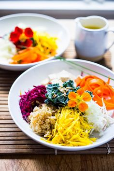 Vegan Sunshine Bowl w/ fresh crunchy veggies- grated beets, carrots, kohlrabi, sunchokes, radish & jicama with nutty brown rice and sunflower tahini sauce.   www.feastingathome.com
