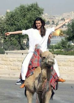 Ziva, on the back of a camel.