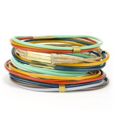 Multiple strands of colorful leather make up this stylish bangle bracelet. Designed and constructed in our Portland studio. | Shop | betsy & iya