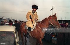 A Chechen volunteer rides a horse as he patrols the streets of the town of Novy Ataguy, some 6 kms south of the capital Grozny, on December 31, 1994. Russian troops launched a massive ground and air assault on the capital on December 31, 1994 after several weeks of bombardments by warplanes to crush the breakaway Caucasus republic's three-year independence drive.