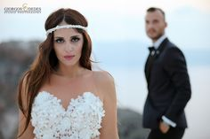 """A portrait is not made in camera but on either side of it. Shooting a beautiful couple with fashion cult. An amazing portrait, by photographer Giorgos Dedes for www.gr in Imerovigli Santorini"