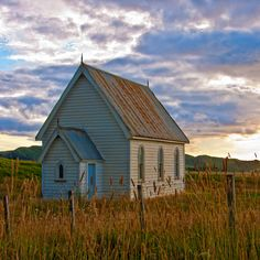 A quaint, abandoned church in New Zealand. Love the tin roof.