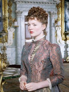 Bel Ami - Holliday Grainger as Suzanne Rousset wearing a silk taffeta dress with lace frilled cuffs and collar. The blouse is buttoned on the front and has an Asian -inspired pattern.