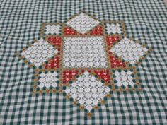 Chicken scratch embroidery-cushion-cover-on-green-gingham.jpg
