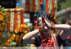 INDIA, KOLKATA: A Russian devotee of the International Society of Krishna Conciousness (ISKON) performs a traditional Indian devotional dance as she waits to pull the holy rope of the Chariot of Lord Jagannath during the Rath Yatra celebration in Kolkata on July 10, 2013. AFP PHOTO/Dibyangshu SARKAR