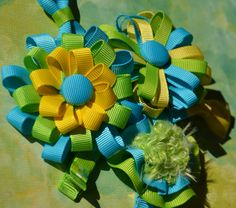 Ribbon Flowers Hair bows in turquoise, yellow, and apple green.
