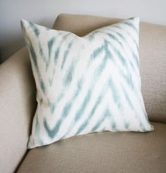 zebra meets chevron in watery blue and creamy white pillow.