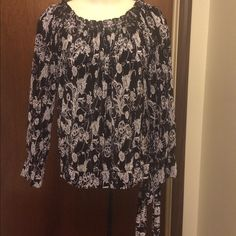 Beautiful Black / White Top $3,$4,$5 ITEMS MUST BE BUNDLEDPrices in this Closet are LOW AND FIRM. No bargaining needed Makes it so much easier to just offer low low prices from the start ASK ALL THE QUESTIONS YOU WANT BEFORE PURCHASING. BUYER AND SELLER AGREE ALL SALES ARE FINAL. TRADE VALUE IS $5.00 HIGHER THAN LISTED SALE PRICE!! Nicola Tops
