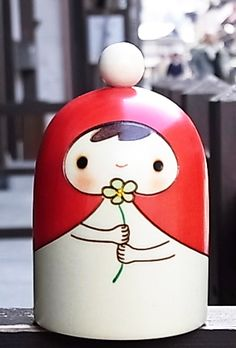 Kokeshi with flower