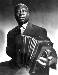 1986 ♦ Lead Belly (1888 - 1949) -  American folk and blues musician notable for his strong vocals, virtuosity on the twelve-string guitar, and the songbook of folk standards he introduced.