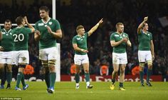 Ireland's replacement fly-half Ian Madigan (centre) celebrates with team mates after winning the Pool D match in Cardiff
