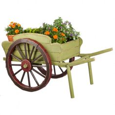 Evergreen Wheel Barrow Planter Statuary Wood Planters, Garden Planters, Flower Cart, Flower Pots, Flowers, Outdoor Garden Decor, Outdoor Gardens, Rustic Wheelbarrows, Wheelbarrow Planter