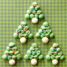 Snowball Trees: String our snowball-like cookie trees with sweet vanilla icing, then add fun pops of color using decorative candies for lights.