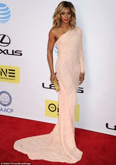 Laverne Cox dazzled at the NAACP Image Awards in Pasadena, California in a gorgeous peach Marc Bouwer gown