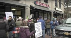 GOP Rep. Rod Blum's constituents rally outside of his office in Cedar Rapids in support of Obamacare.