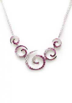 """This beautiful necklace from the """"Zingara"""" collection by Stefan Hafner features wonderful variagated color in an elegant scroll design. Set with 2.02ctw pink sapphires and .59ctw white diamonds, the necklace is 16"""" in length and secures with a lobster clasp."""