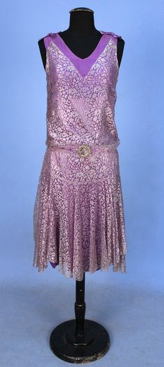 LACE EVENING DRESS, 1920's. Sleeveless lavender lace over lilac chiffon bodice and satin underskirt, shoulders decorated with satin bows, self belt with jeweled buckle.