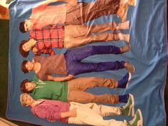 1D blanket From Claire's I want it soooooooooooooooooooooooooooooo badley! We went on choir tour, stoped at the mall, and me and my friend were on the ground exagerating crying cuz we wanted the stuff so badley!!!!!!!!!!1