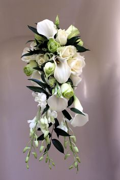 Brides shower bouquet. White calla lillies, orchids and green & white roses. www.uniqueweddingflowers.co.uk