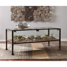 Features: -Bring gardening fun indoors. -Terrarium style 2-door compartment for gardens or display. -Two holes offer fresh air for plant life. -Ideal for lowlight houseplants, succulents, and pott
