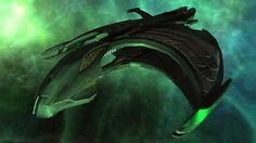 A Romulan D'deridex Warbird Battle Cruiser Retrofit drifts through a nebula in Star Trek Online