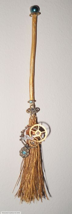 steampunk broom, don't like how the gears are just tacked on rather than being an integrated working part of the broom