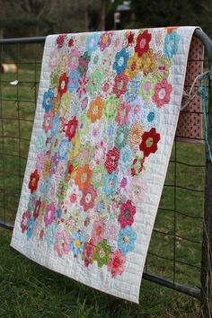 I made a Grandmother's Flower Garden top and simply cannot decide how to bind it....