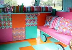 My Campervan interior - mirrored laminate with inset speakers - turquoise and orange rubber flooring - digitally printed laminate for the cupboard doors - digitally printed, hand made curtains & cushions. Sophie Goodenough Design