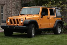 That's my 2012 rubicon in dozer color. Yes, it's parked on my lawn.
