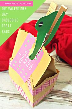 DIY Valentines Day Crocodile Treat Bags. Anyone can buy those cheap Valentines that you can pick up from any store. if you are feeling a little crafty you could make these adorable DIY Valentines Day Crocodile Treat Bags. They can hold a lot more than one piece of candy and aren't that hard to make either. Plus they show you actually put some effort into those Valentines Day parties classroom moms work so hard to throw.