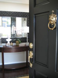 We used an interior/exterior paint on both sides in a black semi-gloss latex {from Dulux}, the shine definitely added a glamorous effect: Lion Head from Lee Valley Tools
