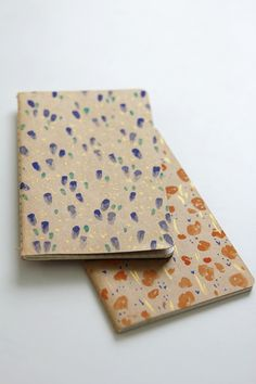 Cute little notebooks,could do it over an old notebook by just folding brown paper over the edges & ta daa u've got a new cover!:)