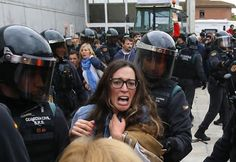 People clash with the civil guard outside a polling station in Sant Julia de Ramis.