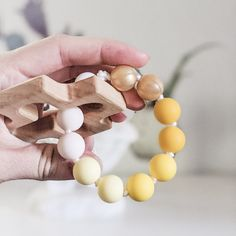 This rosary teething ring is handmade and the recipient was prayed for during its construction by the person that made it. It makes a perfect Baptism gift for a baby girl or boy. The wooden cross is made by a local Catholic artisan. It is cut from durable maple wood, sanded smooth, and finished with a baby safe and food grade mineral oil/beeswax blend. The beads used are FDA approved food grade silicone. Learn more about the bead safety. This item has been third party tested and meets the safety Catholic Baptism Gifts, The Good Catholic, Baby Boy Or Girl, Third Party, Food Grade, New Baby Products, Artisan, Rosaries, Baby Safe