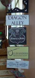 Harry Potter themed hanging signs: Diagon Alley, Flourish & Blotts, Ollivanders, The Daily Prophet.