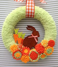 I absolutely love this charming bunny wreath! If you are looking for a cheery way to welcome spring, then this one is for you! This wreath is 10 inches in diameter and is wrapped in a plush sage green yarn. The bunny is made of rusty tin and is nestled in a patch of felt carrots and handmade felt flowers. The orange and white gingham ribbon accents add the final touch of fabulous! My purpose for opening this store was to be able to make a difference for a cause that is near and dear to my…