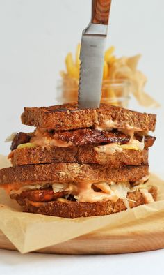 This Vegan Tempeh Reuben is made with marinated and grilled tempeh, homemade Russian Dressing, and seeded rye bread for a classic sandwich.