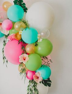 DIY Floral Balloon Arch. We love this DIY idea for a grad party.
